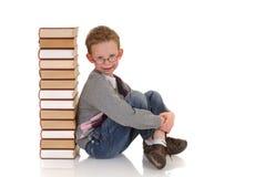 Jonge jongen met encyclopedie Stock Afbeelding