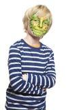 Jonge jongen met gezicht het schilderen monster Stock Foto's
