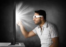 Jongen met 3D glazen Stock Foto