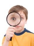 Jonge jongen met het overdrijven glas Royalty-vrije Stock Fotografie