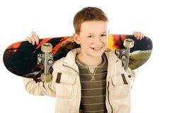 Jonge jongen met skateboard Stock Afbeelding