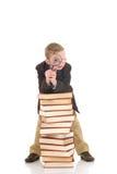 Jonge jongen op boeken Royalty-vrije Stock Afbeeldingen