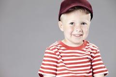 Jonge jongen in studio Stock Fotografie