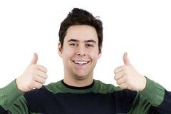 Jonge kerel met twee omhoog duimen Stock Foto