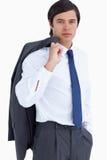 Jonge kleinhandelaar met jasje over zijn schouder Stock Fotografie