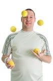 Jonge knappe juggler royalty-vrije stock fotografie