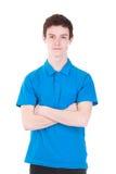Jonge knappe mens in blauwe die t-shirt op wit wordt geïsoleerd stock afbeeldingen