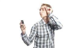 Jonge knappe mens met telefoon Royalty-vrije Stock Afbeelding