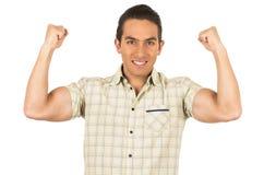 Jonge knappe Spaanse mens die tonend wapen stellen Royalty-vrije Stock Afbeelding