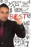 Jonge knappe zakenman die op whiteboard schrijven Stock Foto