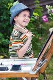 Jonge kunstenaar die zijn werk beginnen Royalty-vrije Stock Foto's