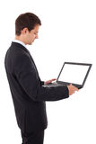 Jonge laptop van de zakenmanholding Royalty-vrije Stock Foto's