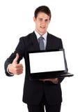 Jonge laptop van de zakenmanholding met omhoog duimen Royalty-vrije Stock Afbeelding
