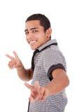 Jonge Latijnse mens met opgeheven duimen - overwinning royalty-vrije stock foto's