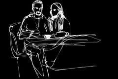 Jonge man en vrouwen het drinken thee in een koffie Stock Afbeeldingen