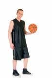 Jonge mannelijke basketbalspeler stock afbeelding