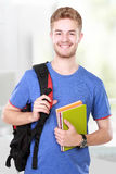 Jonge mannelijke student met boeken Royalty-vrije Stock Foto