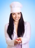 Jonge medische arts met rode pillen in handen royalty-vrije stock foto's