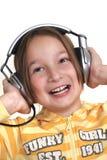 Jonge meisje en hoofdtelefoons royalty-vrije stock afbeeldingen