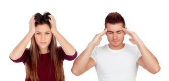Jonge meisje en jongen met hoofdpijn Stock Foto