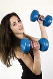 Jonge meisje het opheffen gewichten Stock Afbeelding