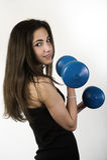 Jonge meisje het opheffen gewichten Royalty-vrije Stock Afbeeldingen