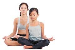 Jonge Meisjes in Yoga Stock Afbeelding