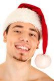 Jonge mens in de rode hoed van Kerstmis Stock Foto's