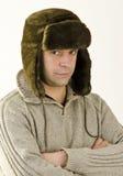 Jonge mens in de winterhoed Stock Foto's