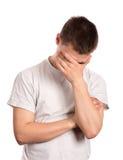 Jonge mens in depressie Stock Foto