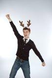 Jonge mens die de hoornen van herten draagt Royalty-vrije Stock Afbeeldingen