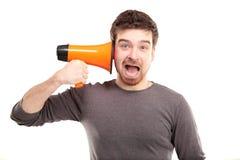 Mens die door megafoon schreeuwen Royalty-vrije Stock Foto's