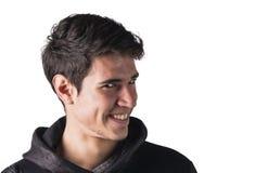 Jonge mens die dwaas gezicht en stomme uitdrukking doen Stock Afbeelding