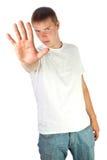 Jonge mens die einde maakt met zijn hand ondertekenen Royalty-vrije Stock Foto's
