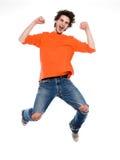 Jonge mens die gelukkige vreugde gilt Royalty-vrije Stock Afbeelding