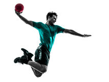 Jonge mens die het silhouet van de handbalspeler uitoefenen Royalty-vrije Stock Foto