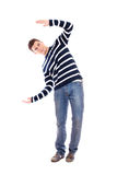 Jonge mens die iets voorstelt Stock Fotografie