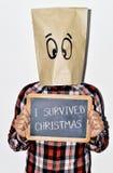 Jonge mens die Kerstmis overleefde Stock Foto
