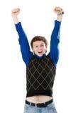 Jonge mens die met zijn vuisten in de lucht gilt Stock Foto's