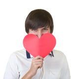 Jonge mens die rood hart houdt stock fotografie