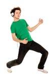 Jonge mens die van muziek geniet Stock Foto