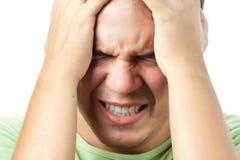 Jonge mens die zeer sterke geïsoleerdee pijn heeft Royalty-vrije Stock Foto