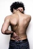 Jonge mens met lagere rug en halspijn Stock Foto's