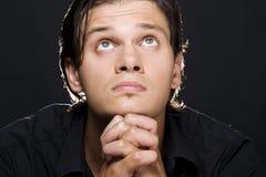 Jonge mens het bidden Royalty-vrije Stock Afbeelding