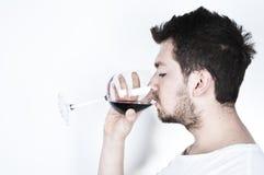 Jonge mens het drinken wijn Royalty-vrije Stock Afbeelding