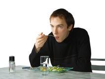 Jonge mens het eten Stock Fotografie