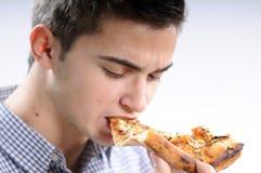 Jonge mens het eten Stock Afbeelding
