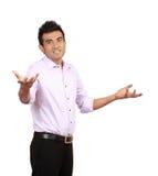Jonge mens het gesturing kent geen teken Stock Afbeeldingen