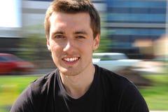 Jonge mens het glimlachen. Motie royalty-vrije stock afbeelding