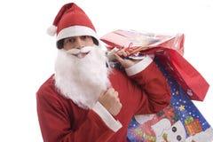 Jonge Mens in het kostuum van de Kerstman, volledig van giften Stock Afbeeldingen